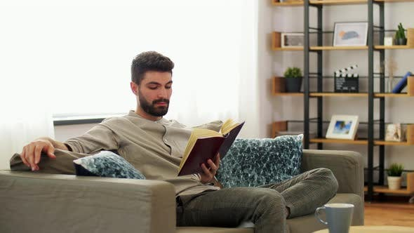 Thumbnail for Man Reading Book at Home