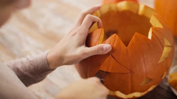 Thumbnail for Woman Carving Halloween Pumpkin