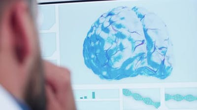 Close Up Shoot of Doctor Looking at 3D Brain Model