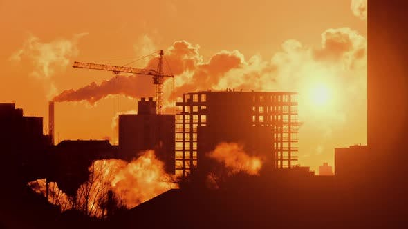 Thumbnail for Construction Crane Working on Building Cityscape Constructors Working at Sunrise Sunset Golden Hour