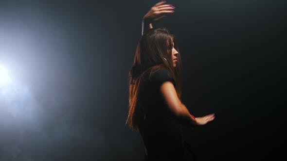 Thumbnail for Young Woman with Long Dark Hair Dancing in the Dark