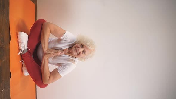 Adult Woman Does Sports Yoga and Basic Yoga Poses at Home