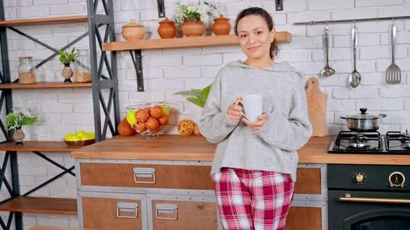 Brunette with Mug at Home