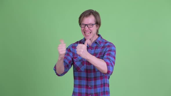 Thumbnail for Happy Young Handsome Hipster Man Giving Thumbs Up and Looking Excited