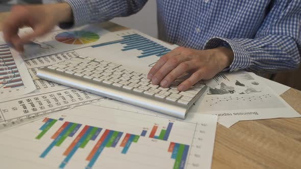 Thumbnail for Financial Analyst Using Accounting Business App, Economist Analyzing Statistics,