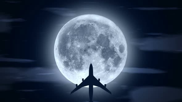Passenger Airplane Over Moon in Cloudy Night