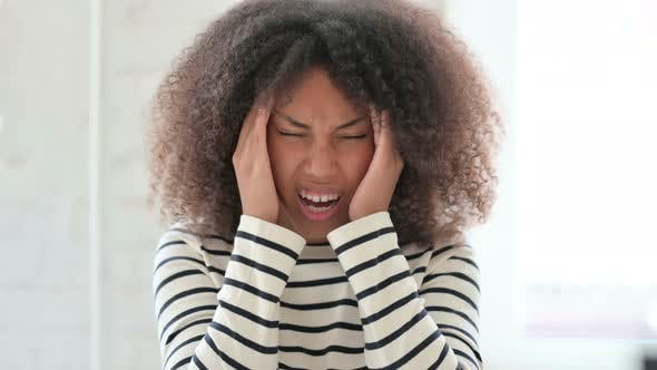 Exhausted African Woman Having Headache