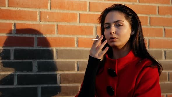 Thumbnail for A Young Woman Smokes a Cigarette