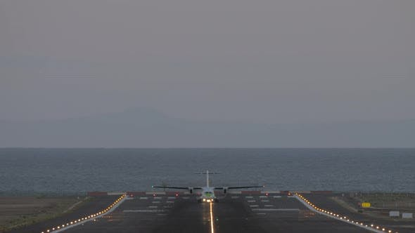 Thumbnail for Airliner Departing From Airport By Sea in the Evening