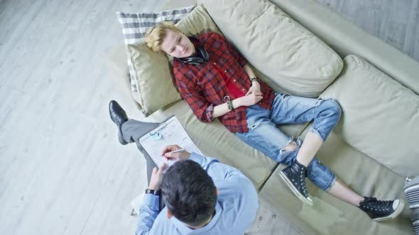 Thumbnail for Teenager Lying on Sofa during Psychotherapy