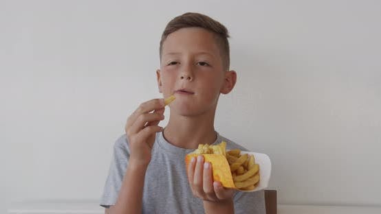 Thumbnail for Happy Little Child Boy Eating French Fries, Health Care and Food Concept
