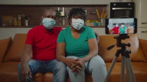 Sick Elderly Black Couple in Face Mask on Self Isolation