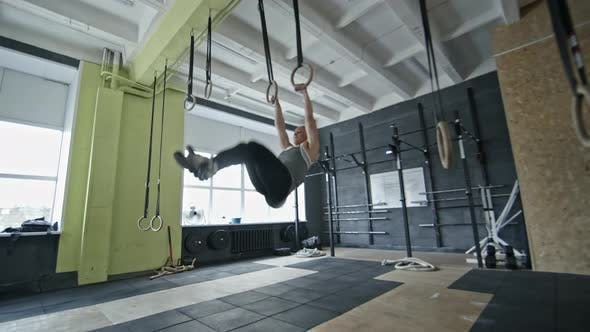 Cover Image for Sporty Woman Doing Pull-Ups on Rings