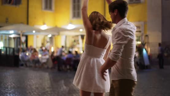 Thumbnail for Happy carefree couple dancing on street in Italy
