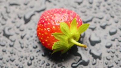 Strawberry Covered with Water Droplets are Spinning