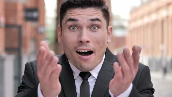 Thumbnail for Shocked Businessman Wondering in Awe, Outdoor