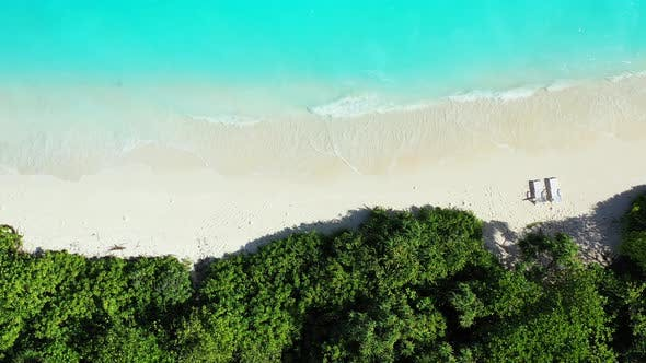 Thumbnail for Daytime aerial travel shot of a summer white paradise sand beach and blue ocean background in hi res