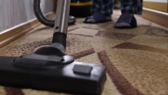 Thumbnail for Cleaning Brown Carpet With Vacuum Cleaner