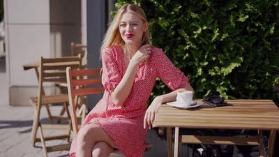 Cheerful Young Woman Resting in Cafe