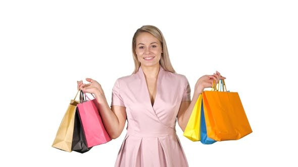 Thumbnail for Shopping woman happy smiling holding shopping bags iwhile