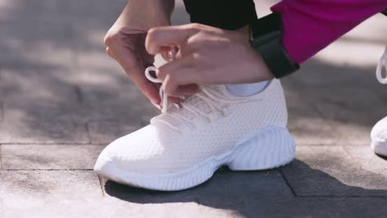Thumbnail for Close Up of Female Runner Tying Shoelaces on White Sneakers and Running Away, Slow Motion