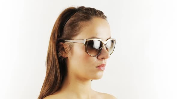 Thumbnail for Pretty woman wearing different retro sunglasses