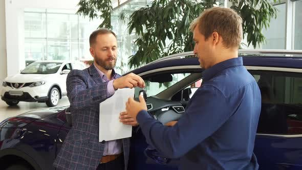 Thumbnail for Car Dealer Hands Over the Keys To the New Owner