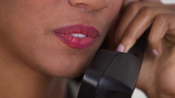 Black business woman talking on telephone