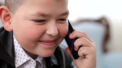 Little boy talking on a smartphone