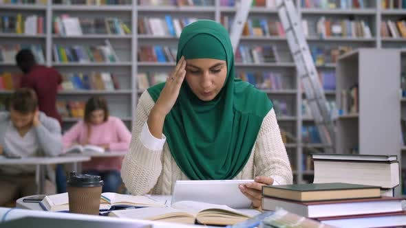 Thumbnail for Tired Arab Female Student Suffering Headache