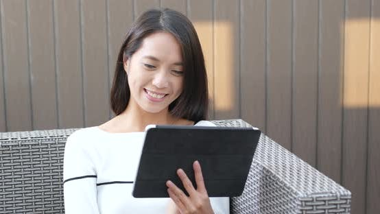 Thumbnail for Woman watching on digital tablet computer