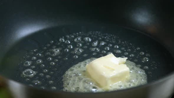 Thumbnail for Butter Cube Melting And Sizzling In Frying Pan