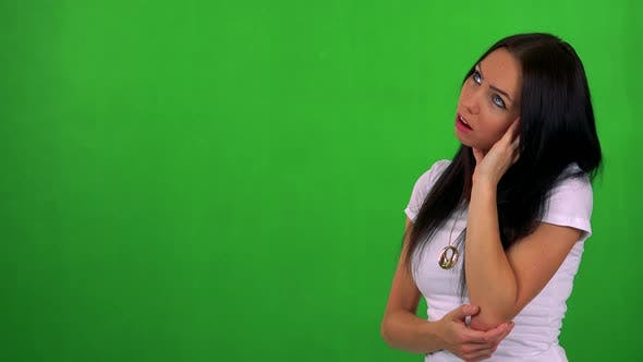 Thumbnail for Young Pretty Woman Is Bored - Green Screen - Studio