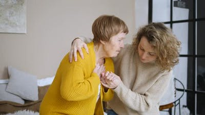 Young Woman Taking Care Of Senior Woman. Family Care