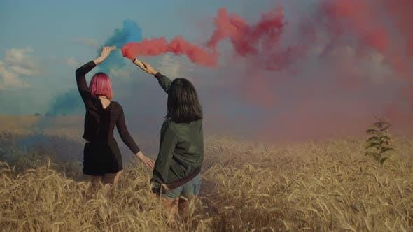 Females Enjoying Outdoor Leisure with Smoke Bombs