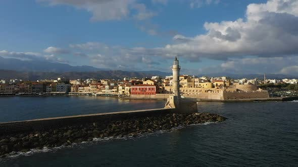 Aerial Drone Video of Iconic Venetian Lighthouse in the Entrance of Picturesque Old Port of Chania
