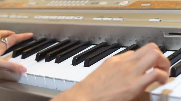 Thumbnail for Musician Plays On An Electronic Piano