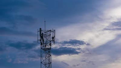 day to night time lapse of Telecommunication tower Antenna at sunset