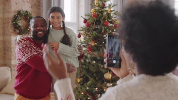 Thumbnail for Happy Black Father and Daughter Posing by Christmas Tree