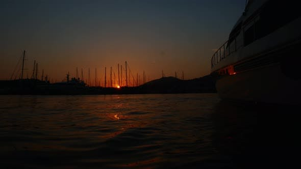 Thumbnail for Time Lapse Sunrise in the Port of the Resort Town of Bodrum, Turkey. Luxury Yacht Moored in the Bay