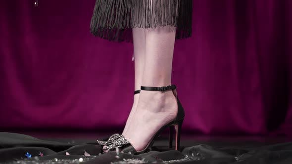 Thumbnail for Woman's Legs in High Heels and Dress on the Background with Falling Sparkles