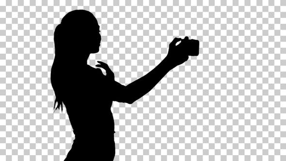 Thumbnail for Silhouette girl taking a selfie and walking, Alpha Channel