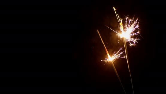 New Year's Sparklers Are Lit By Flames.