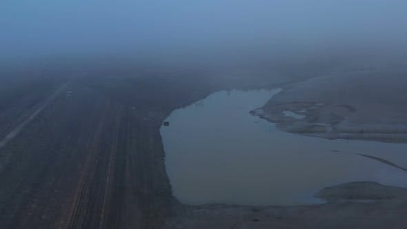 Flight Over A Dry Dam In The Autumn Foggy Day In The Late Afternoon 1