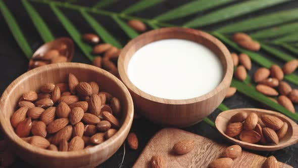 Thumbnail for Close Up of Almonds in Wooden Bowl and Almond Milk
