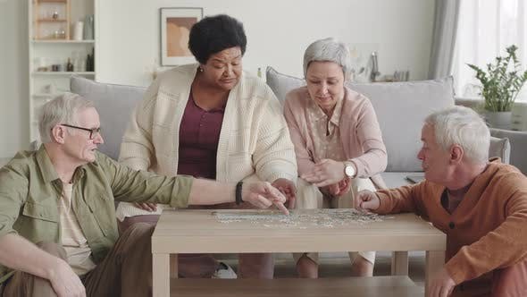 Elderly People Doing Puzzle at Home