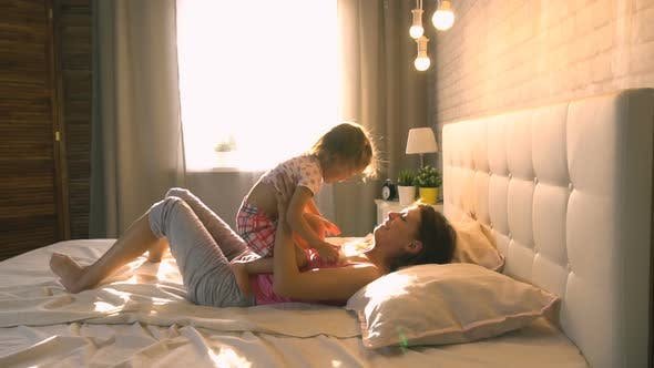 Thumbnail for Mom With Daughter At Home On The Bed