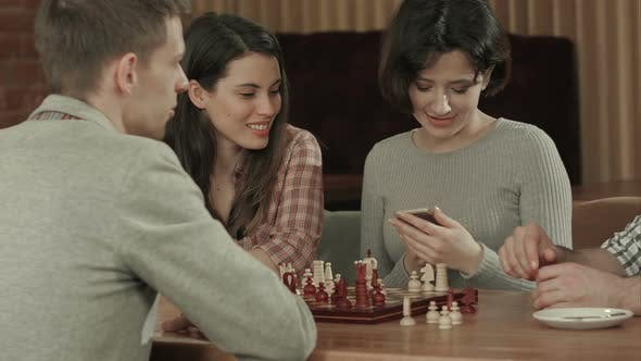 Thumbnail for Girl Taking Photo of Playing Chess