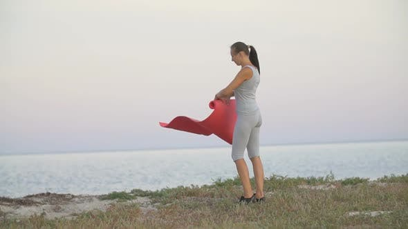 Thumbnail for Girl Is Training on the Beach