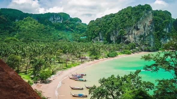 Thumbnail for Hat Tom Sai Beach with Long Tail Boats on the Beach, Railay Travel Destination Near Ao Nang, Krabi